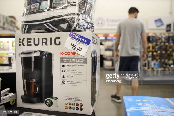 A Keurig Green Mountain Inc coffee maker sits on display for sale at a WalMart Stores Inc location in Burbank California US on Tuesday Aug 8 2017...