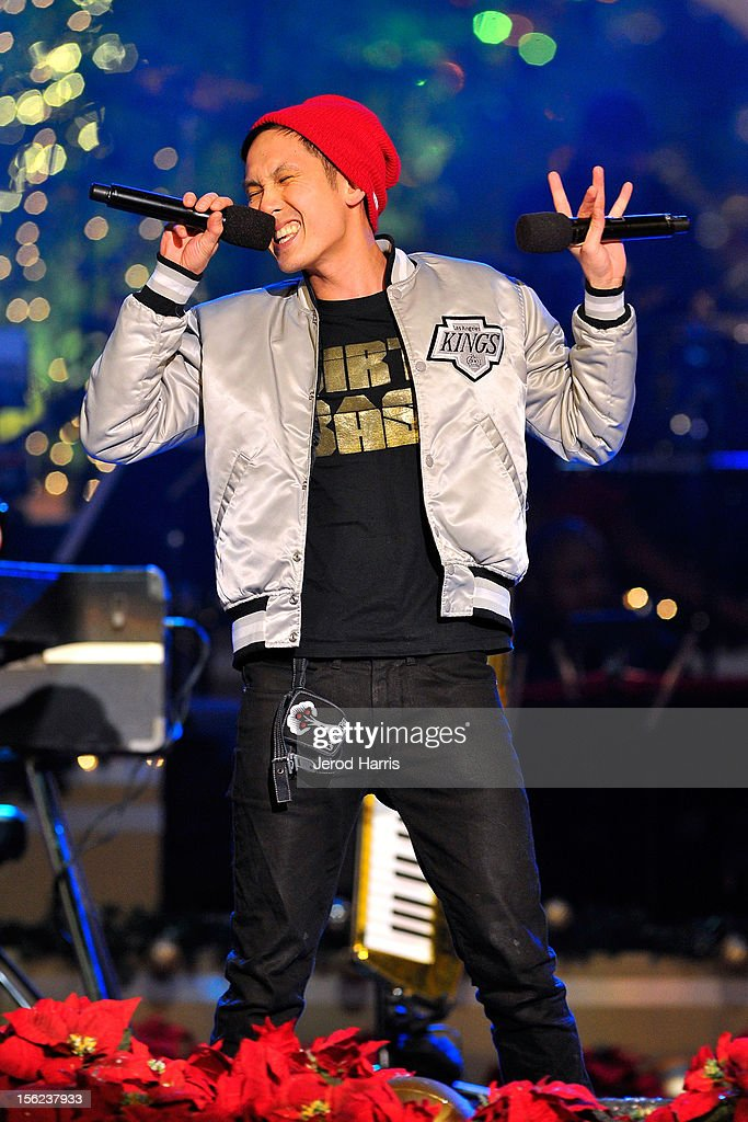 <a gi-track='captionPersonalityLinkClicked' href=/galleries/search?phrase=Kev+Nish&family=editorial&specificpeople=7240613 ng-click='$event.stopPropagation()'>Kev Nish</a> of Far East Movement performs at A Hollywood Christmas Celebration at The Grove on November 11, 2012 in Los Angeles, California.