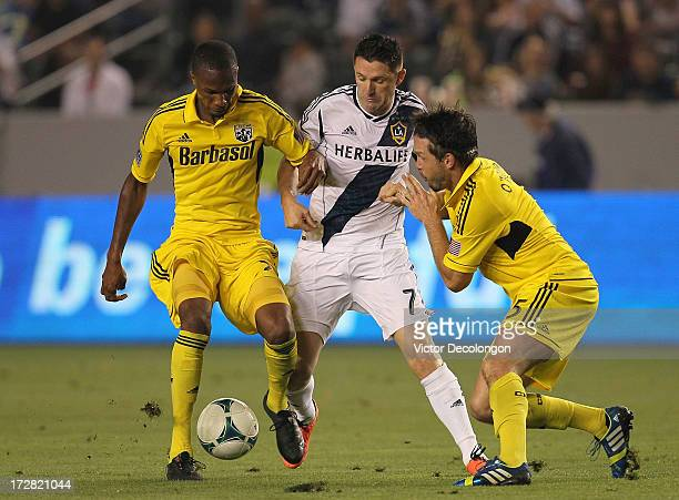 Kevan George and Danny O'Rourke of the Columbus Crew defend the play of Robbie Keane the Los Angeles Galaxy in the second half during the MLS match...