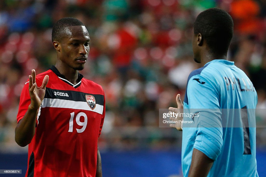 Kevan George of Trinidad Tobago congratulates goalkeeper Marvin Phillip after defeating Cuba 20 following the 2015 CONCACAF Gold Cup group C match at...