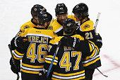 Kevan Miller of the Boston Bruins celebrates with David Krejci Torey Krug Loui Eriksson and Dennis Seidenberg after scoring against the Columbus Blue...