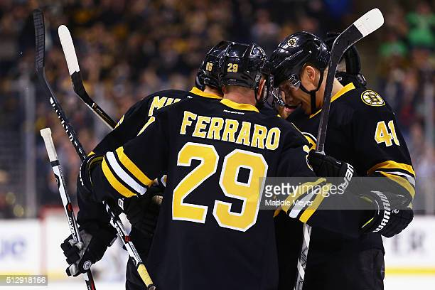 Kevan Miller of the Boston Bruins celebrates with Landon Ferraro and Joonas Kemppainen after scoring against the Tampa Bay Lightning during the first...