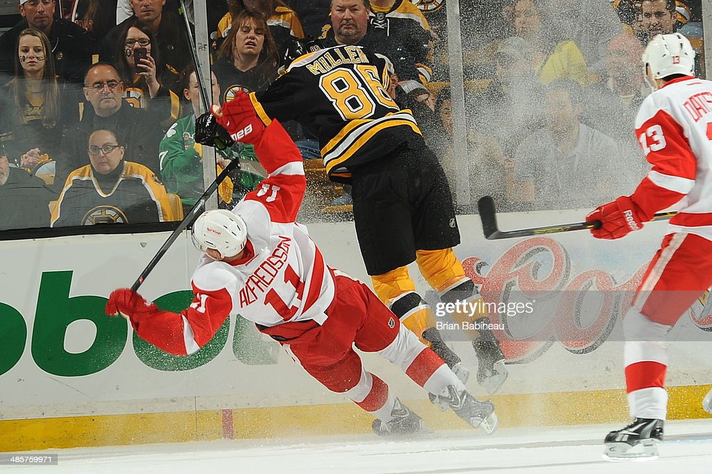 <a gi-track='captionPersonalityLinkClicked' href=/galleries/search?phrase=Kevan+Miller&family=editorial&specificpeople=8236132 ng-click='$event.stopPropagation()'>Kevan Miller</a> #86 of the Boston Bruins checks against <a gi-track='captionPersonalityLinkClicked' href=/galleries/search?phrase=Daniel+Alfredsson&family=editorial&specificpeople=201853 ng-click='$event.stopPropagation()'>Daniel Alfredsson</a> #11 of the Detroit Red Wings in Game Two of the First Round of the 2014 Stanley Cup Playoffs at TD Garden on April 20, 2014 in Boston, Massachusetts.