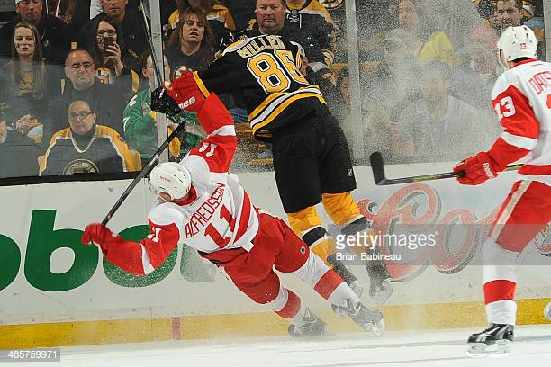 Kevan Miller of the Boston Bruins checks against Daniel Alfredsson of the Detroit Red Wings in Game Two of the First Round of the 2014 Stanley Cup...