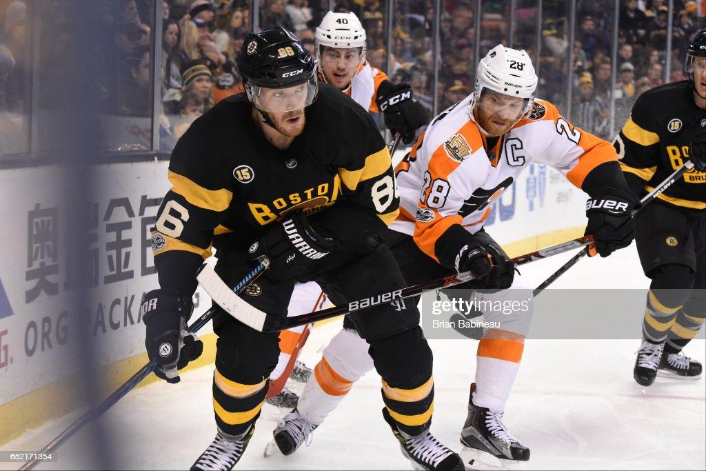 Kevan Miller #86 of the Boston Bruins skates against Claude Giroux #28 of the Philadelphia Flyers at the TD Garden on March 11, 2017 in Boston, Massachusetts.