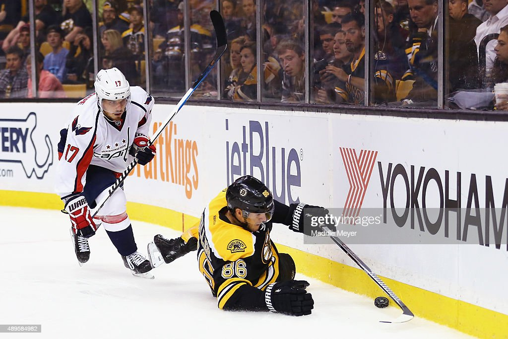 Kevan Miller #86 of the Boston Bruins tries to maintain control of the puck with pressure from Chris Bourque #17 of the Washington Capitals during the second period at TD Garden on September 22, 2015 in Boston, Massachusetts.