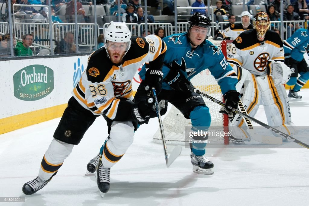 Kevan Miller #86, Tuukka Rask #40 of the Boston Bruins along with Chris Tierney #50 of the San Jose Sharks look during a NHL game at SAP Center at San Jose on February 19, 2017 in San Jose, California.