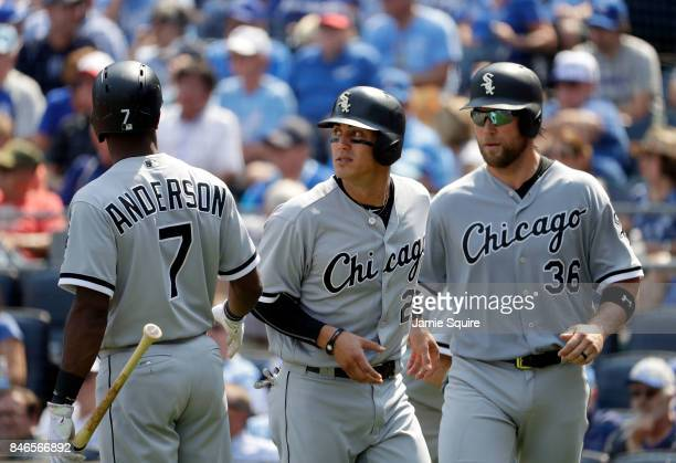 Kevan Smith and Tyler Saladino of the Chicago White Sox are congratulated by Tim Anderson after scoring during the 2nd inning of the game against the...