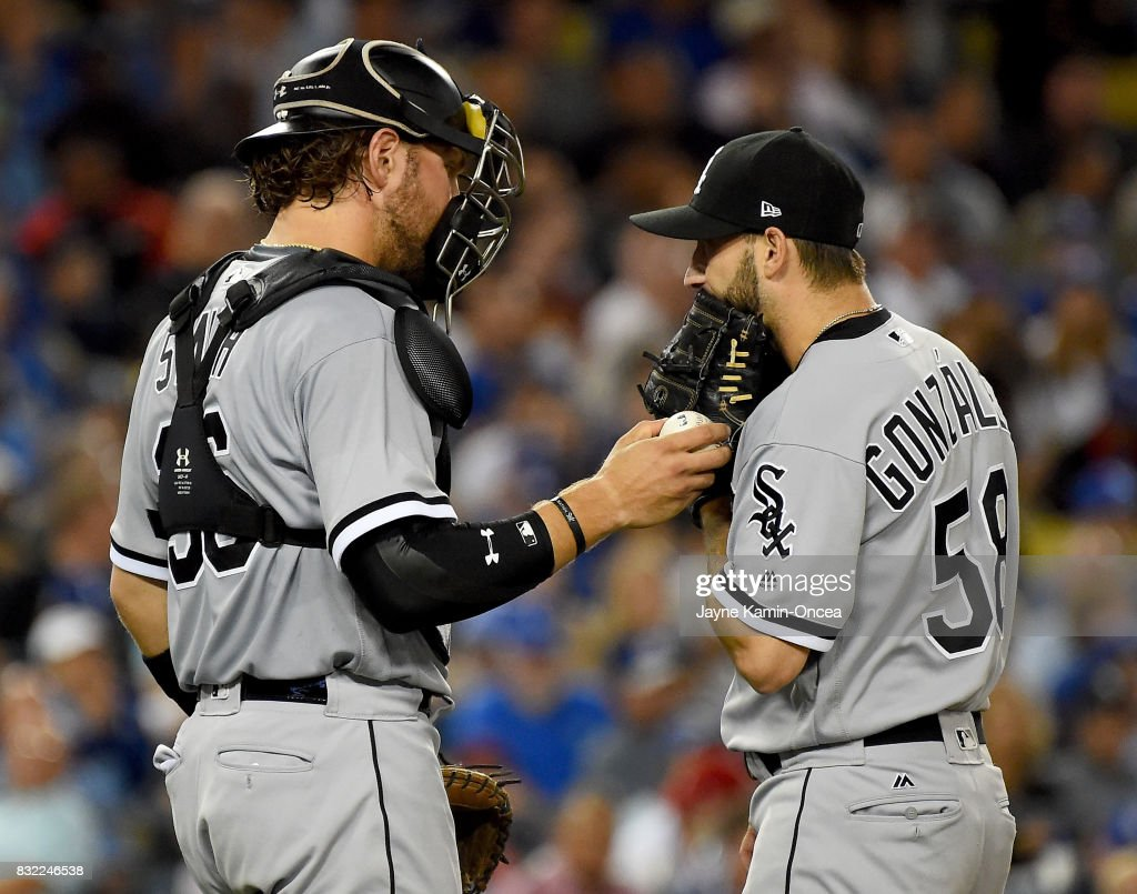 Kevan Smith #36 of the Chicago White Sox talks with Miguel Gonzalez #58 on the pitchers mound in the sixth inning of the game against the Los Angeles Dodgers at Dodger Stadium on August 15, 2017 in Los Angeles, California.