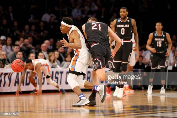 KeVaughn Allen of the Florida Gators collides with Maik Kotsar of the South Carolina Gamecocks in the first half during the 2017 NCAA Men's...