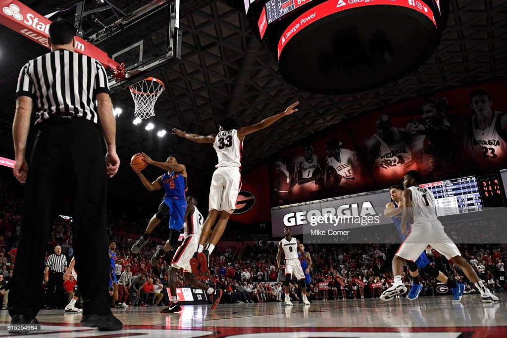 KeVaughn Allen #5 of the Florida Gators drives past Nicolas Claxton #33 of the Georgia Bulldogs late in the second half of the basketball game at Stegeman Coliseum on January 30, 2018 in Athens, Georgia.