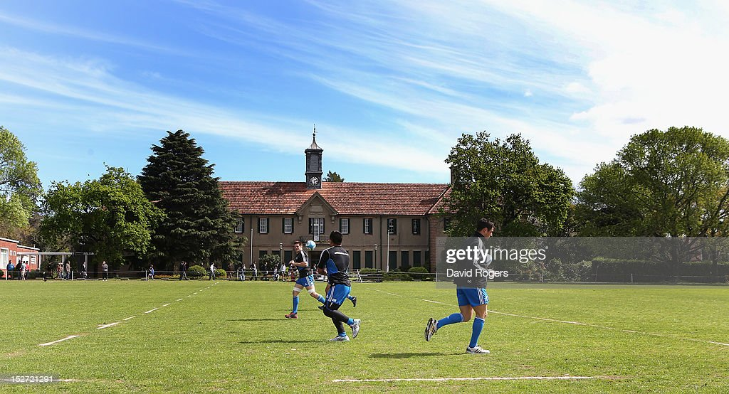 Keven Mealamu passes the ball to Richie McCaw during a New Zealand All Blacks training session at Saint George's College on September 24, 2012 in Buenos Aires, Argentina.