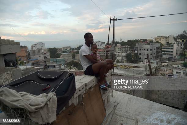 Kevens and his sister are seen in the roof of their house in Jalousie neighborhood in the commune of Petion Ville in the Haitian capital PortauPrince...