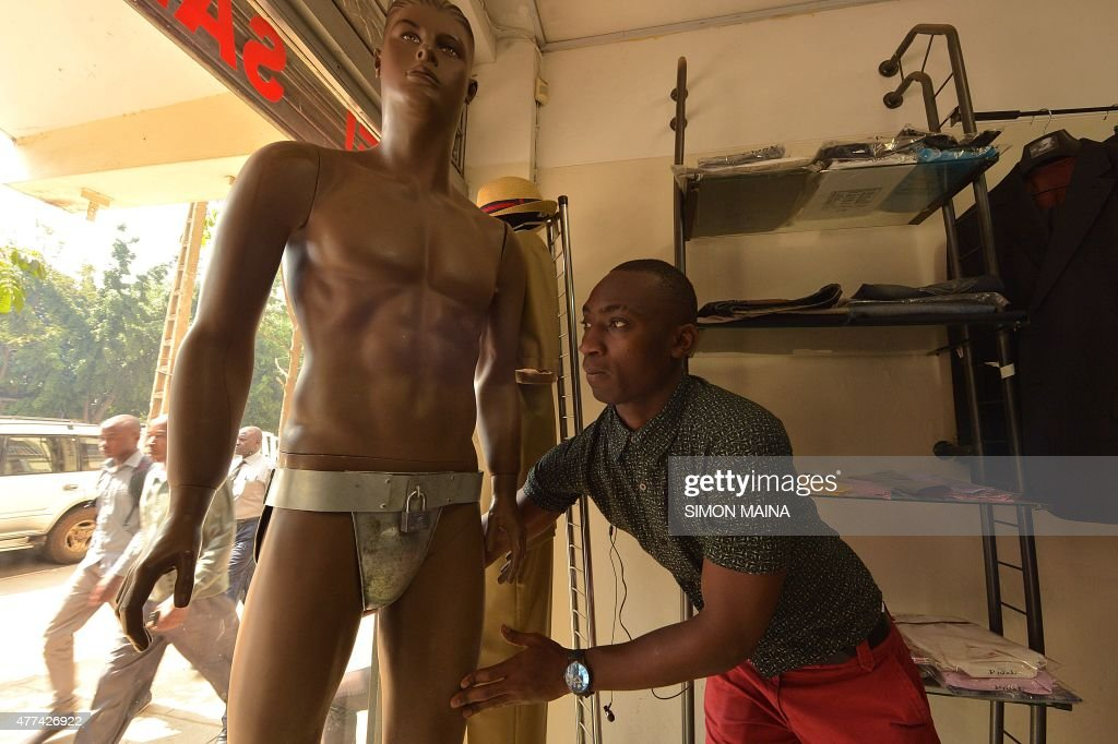 Kevin a worker in a men's clothing shop moves a mannequin wearing a chastity belt with an iron padlock on sale for 20 USD on June 17 2015 in Nairobi...