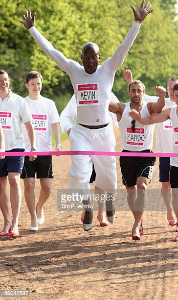 Kevin Adams leads a group of men all wearing womens high heels in support of Cancer Research UK�s Race for Life 2009 series in Regents Park on April...