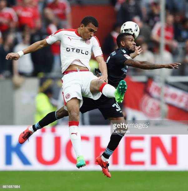 Kevin Akpoguma of Duesseldorf jumps for a header with Amilton of 1860 Muenchen during the Second Bundesliga match between Fortuna Duesseldorf and TSV...