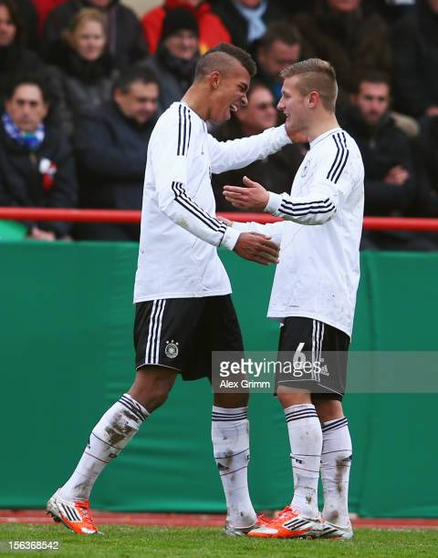 Kevin Akpoguma of Germany celebrates his team's second goal with team mates Tim Hoelscher during the U18 international friendly match between Germany...