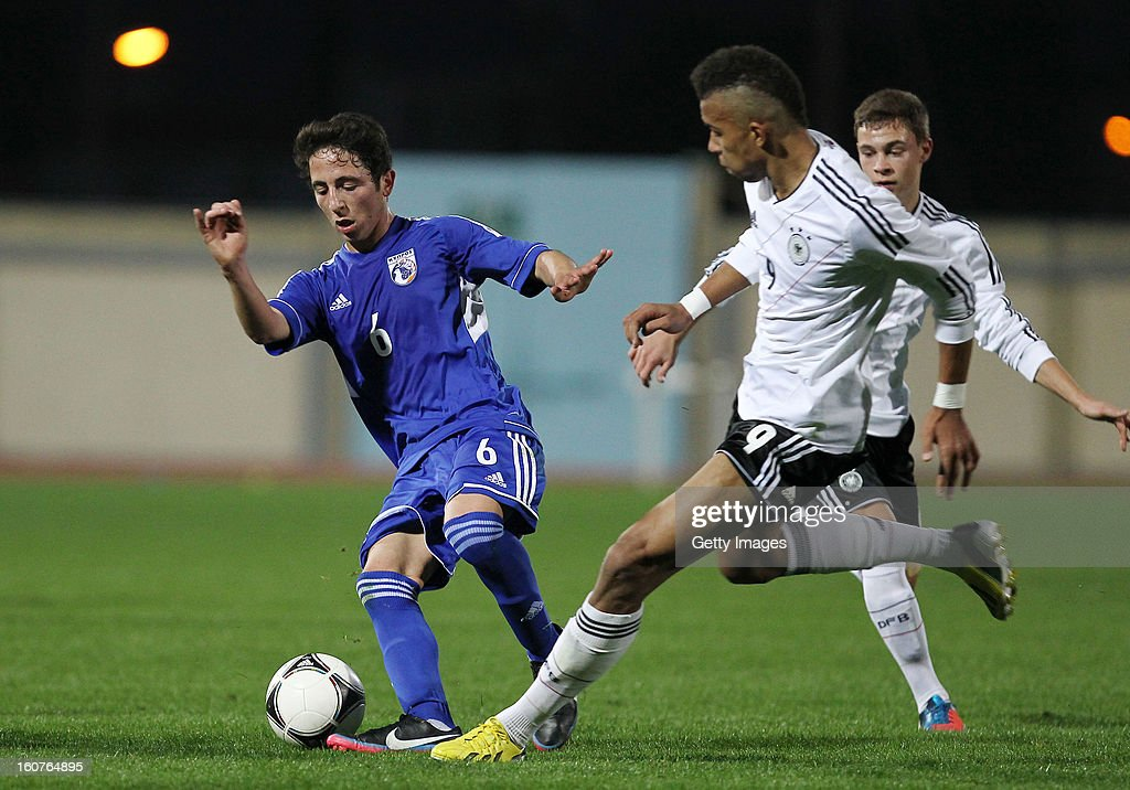 Kevin Akpoguma (r) of Germany challenges Sergidi Diogenis of Cyprus during the international friendly match between U18 Cyprus and U18 Germany at Stadio Tasos Markou on February 5, 2013 in Paralimni, Cyprus.