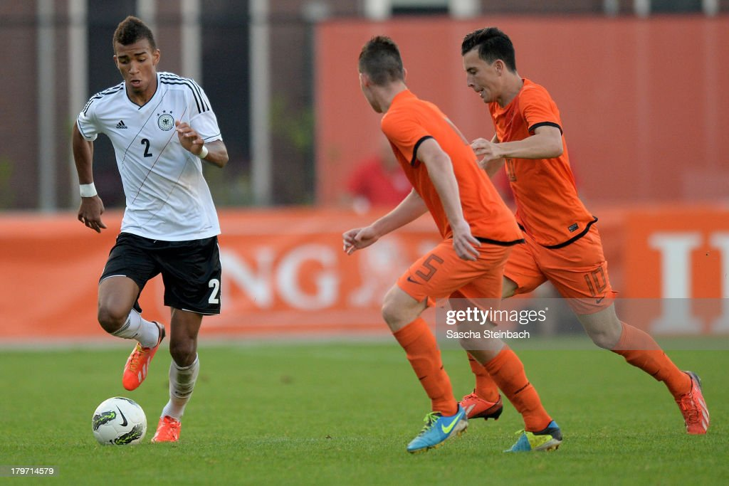 Kevin Akpoguma of Germany competes for the ball with Thom Haye and Sander Heesakkers of The Netherlands during the U19 international friendly match between The Netherlands and Germany on September 6, 2013 in Nijmegen, Netherlands.