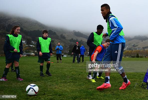 Kevin Akpoguma of Germany plays a game of football with children of the Hawks Club at Ferrymead Park on June 2 2015 in Christchurch New Zealand