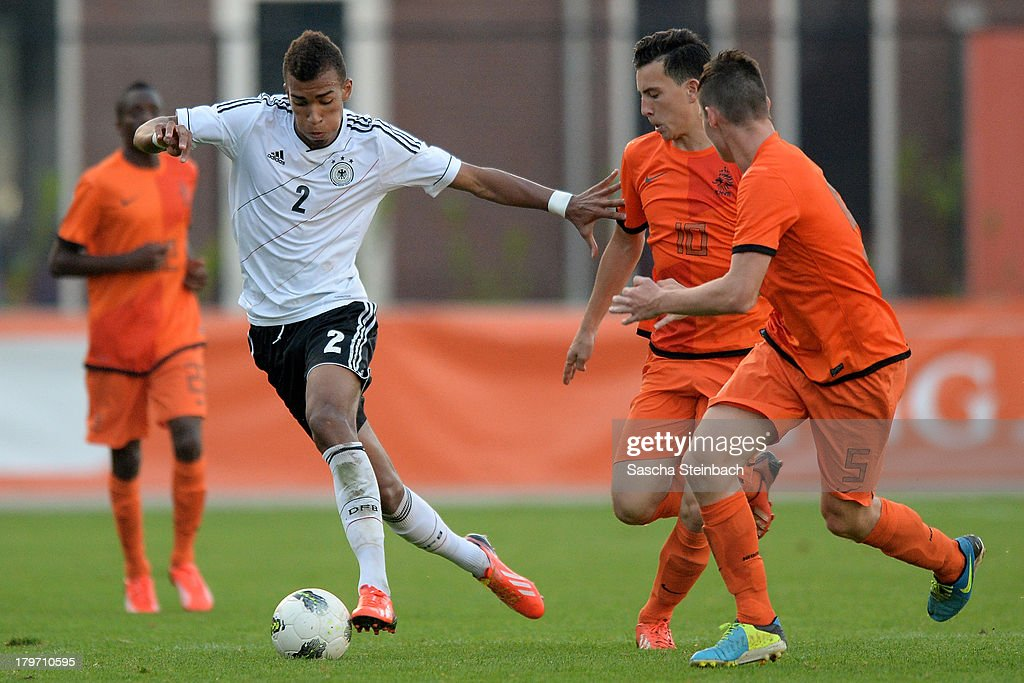Kevin Akpoguma of Germany vies with Thom Haye and Sander Heesakkers of The Netherlands during the U19 international friendly match between The Netherlands and Germany on September 6, 2013 in Nijmegen, Netherlands.