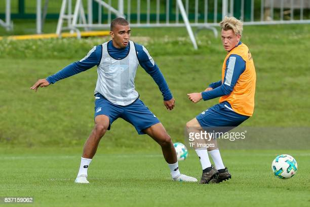 Kevin Akpoguma of Hoffenheim and Robin Hack of Hoffenheim battle for the ball during the Training Camp of TSG 1899 Hoffenheim on July 16 2017 in...