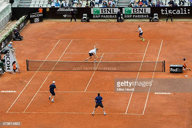 Kevin Anderson of South Africa and Jeremy Chardy of France in action against Pablo Cuevas of Argentina and David Marrero of Spain in their Men's...