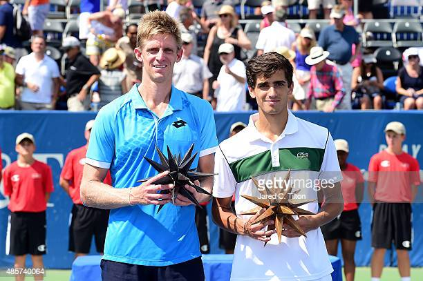 Kevin Anderson of South Africa and PierreHugues Herbert of France pose with the trophy after men's final match of the WinstonSalem Open at Wake...