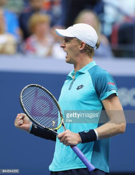 Kevin Anderson of South Africa celebrates winning the second set against Pablo Carreno Busta of Spain during their Men's Singles Semifinal match on...