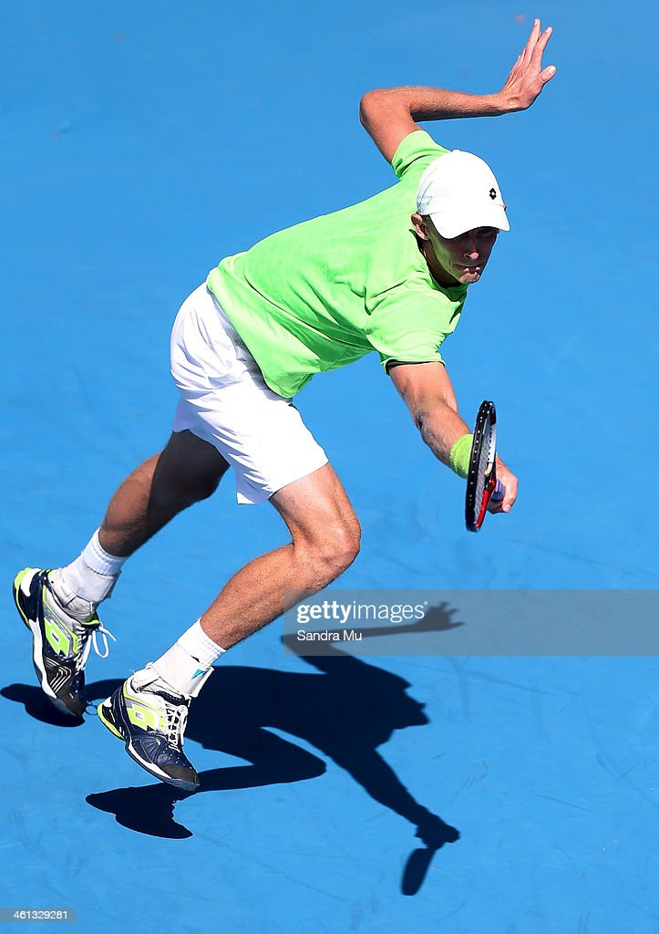 Kevin Anderson of South Africa plays a backhand during his match against Steve Johnson of USA on day three of the Heineken Open at ASB Tennis Centre on January 8, 2014 in Auckland, New Zealand.