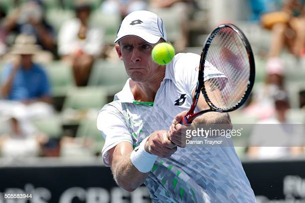 Kevin Anderson of South Africa plays a backhand in his first round match against Rajeev Ram of the United States during day two of the 2016...