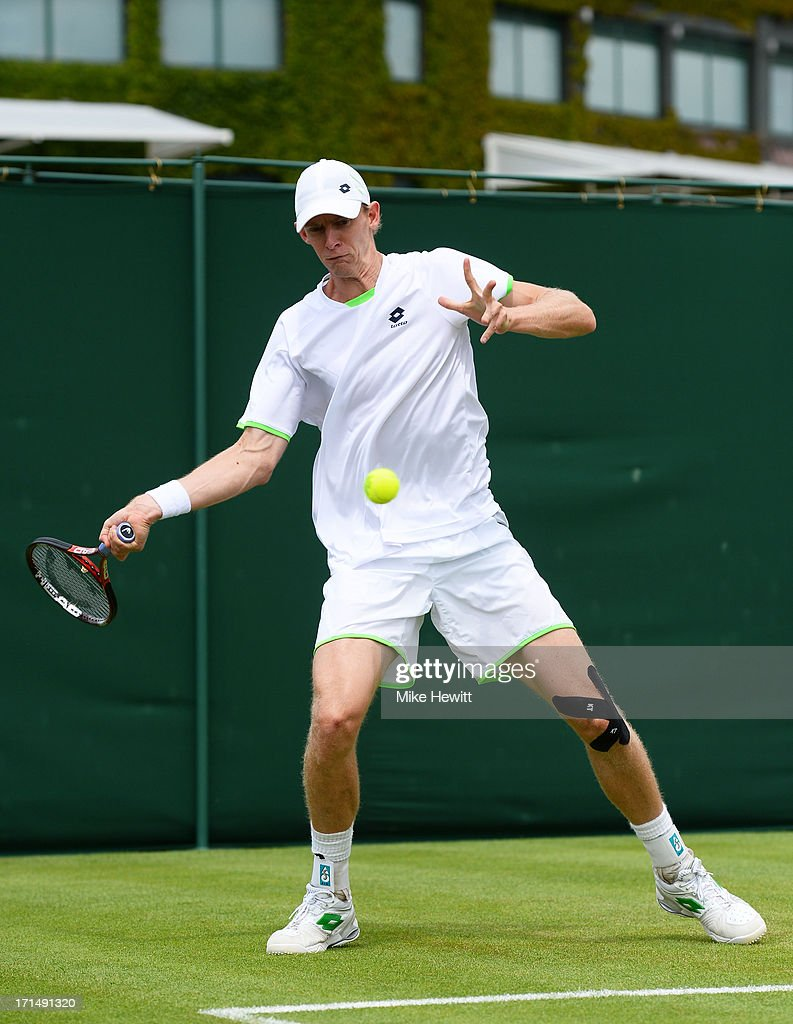 Kevin Anderson of South Africa plays a forehand during the Gentlemen's Singles first round match against Olivier Rochus of Belgium on day two of the Wimbledon Lawn Tennis Championships at the All England Lawn Tennis and Croquet Club on June 25, 2013 in London, England.