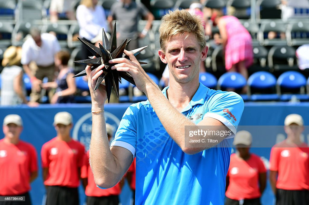Kevin Anderson of South Africa poses with the trophy after defeating Pierre-Hugues Herbert of France during the men's final match of the Winston-Salem Open at Wake Forest University on August 29, 2015 in Winston-Salem, North Carolina. Anderson won the match in straight sets 6-4, 7-5.
