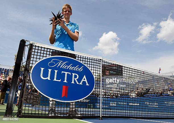 Kevin Anderson of South Africa poses with the trophy after defeating PierreHugues Herbert of France during the men's final match of the WinstonSalem...