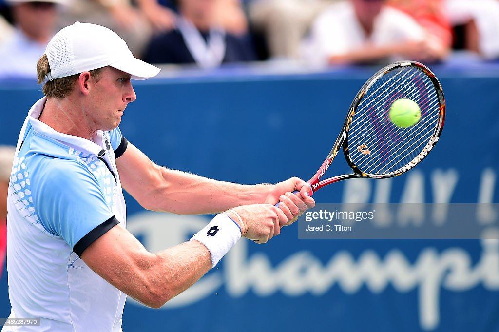 Kevin Anderson of South Africa returns a shot from Jerzy Janowicz of Poland during the third day of the Winston-Salem Open at Wake Forest University on August 26, 2015 in Winston-Salem, North Carolina.