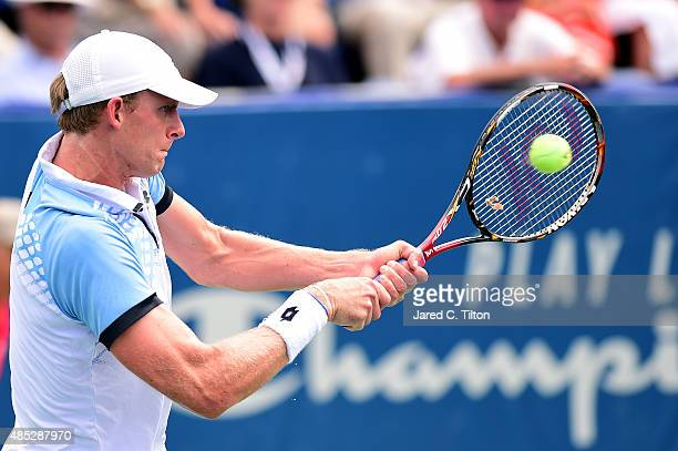 Kevin Anderson of South Africa returns a shot from Jerzy Janowicz of Poland during the third day of the WinstonSalem Open at Wake Forest University...