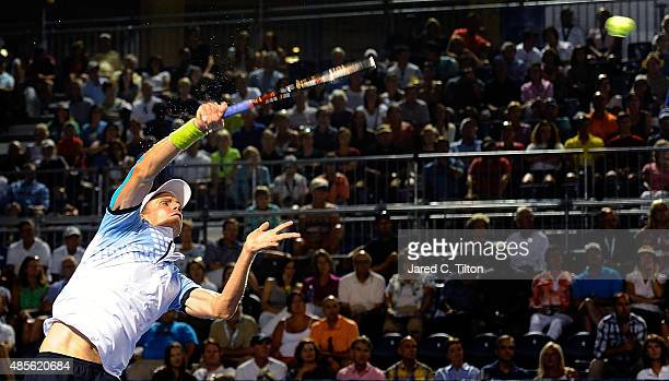 Kevin Anderson of South Africa returns a shot from Malek Jaziri of Tunisia during the fifth day of the WinstonSalem Open at Wake Forest University on...