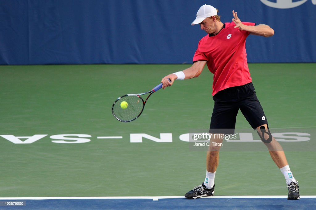 Kevin Anderson of South Africa returns a shot from Sam Querrey during the Winston-Salem Open at Wake Forest University on August 20, 2014 in Winston Salem, North Carolina.