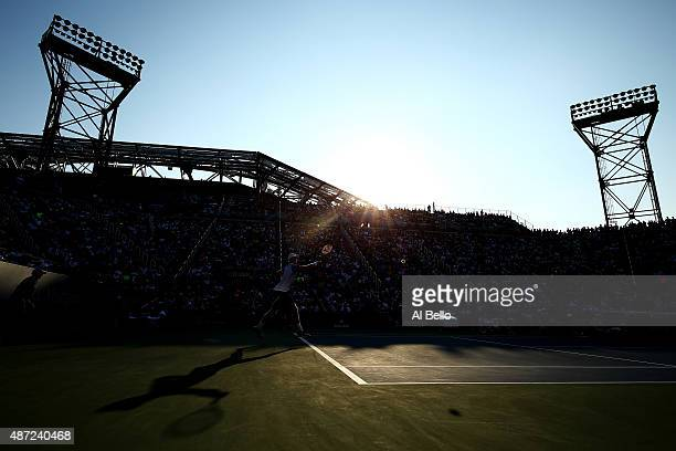 Kevin Anderson of South Africa returns a shot to Andy Murray of Great Britain during their Men's Singles Fourth Round match on Day Eight of the 2015...