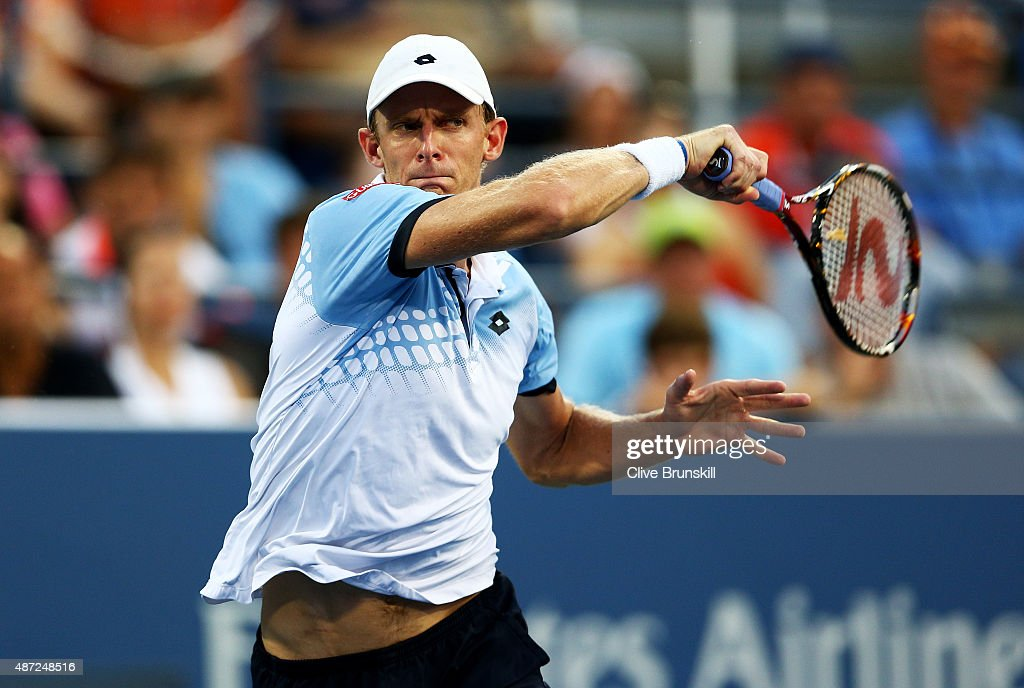 Kevin Anderson of South Africa returns a shot to Andy Murray of Great Britain during their Men's Singles Fourth Round match on Day Eight of the 2015 US Open at the USTA Billie Jean King National Tennis Center on September 7, 2015 in the Flushing neighborhood of the Queens borough of New York City.