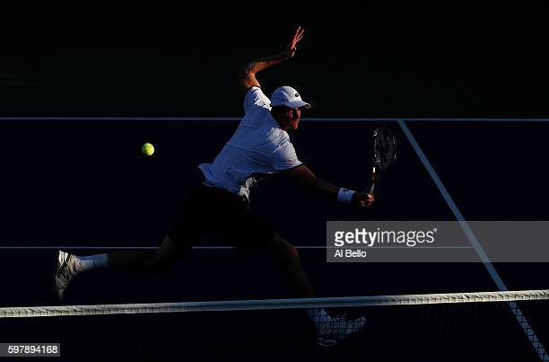 Kevin Anderson of South Africa returns a shot to Yoshihito Nishioka of Japan during his first round Men's Singles match on Day One of the 2016 US...