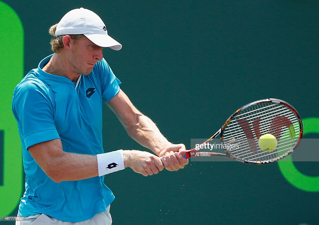 Kevin Anderson of South Africa returns the ball against Sam Querrey during day 5 of the Miami Open at Crandon Park Tennis Center on March 27, 2015 in Key Biscayne, Florida.