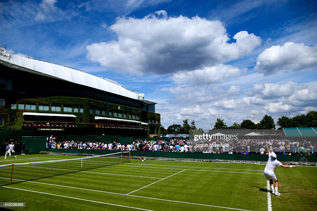 <a gi-track='captionPersonalityLinkClicked' href=/galleries/search?phrase=Kevin+Anderson+-+Tennis+Player&family=editorial&specificpeople=5405822 ng-click='$event.stopPropagation()'>Kevin Anderson</a> of South Africa serves during his first round match against Denis Istomin of Uzbekistan during day one of the Wimbledon Lawn Tennis Championships at the All England Lawn Tennis and Croquet Club on June 26, 2016 in London, England.