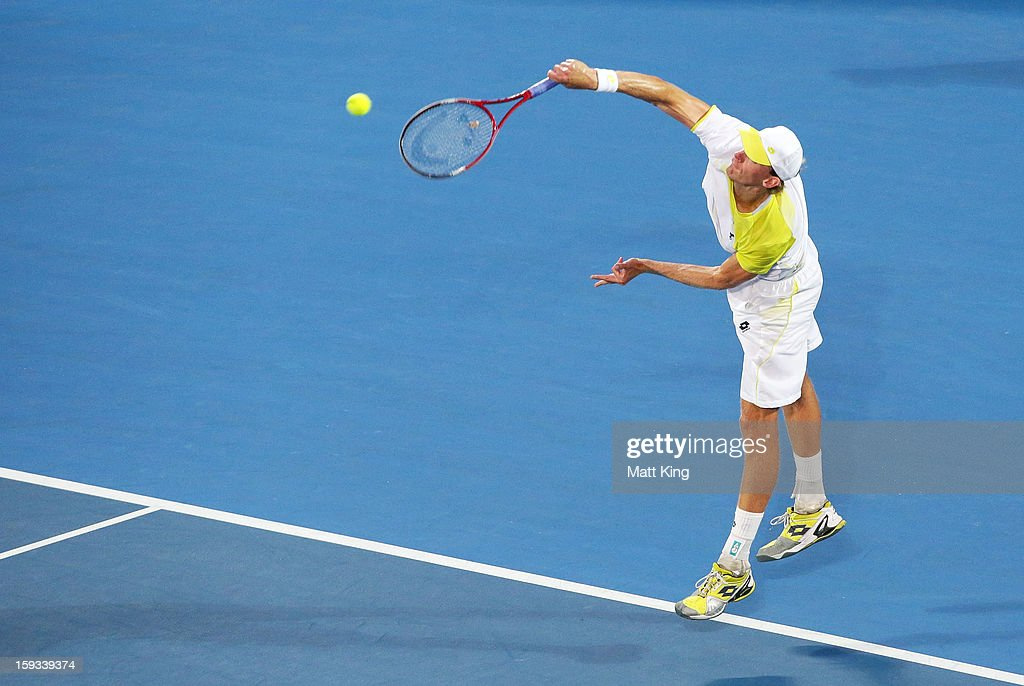 Kevin Anderson of South Africa serves in the men's final match against Bernard Tomic of Australia during day seven of the Sydney International at Sydney Olympic Park Tennis Centre on January 12, 2013 in Sydney, Australia.