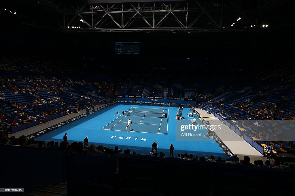 Kevin Anderson of South Africa serves the ball in the opening match between Spain and South Africa during day one of the Hopman Cup at Perth Arena on December 29, 2012 in Perth, Australia.