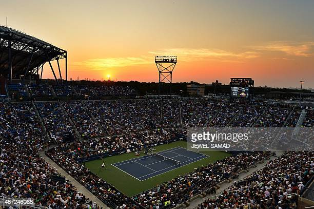 Kevin Anderson of South Africa serves to Andy Murray of Britain during their 2015 US Open Men's singles round 4 match at the USTA Billie Jean King...
