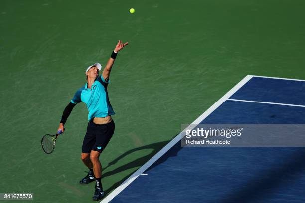 Kevin Anderson of South Africa serves to Borna Coric of Croatia during his third round match on Day Five of the 2017 US Open at the USTA Billie Jean...