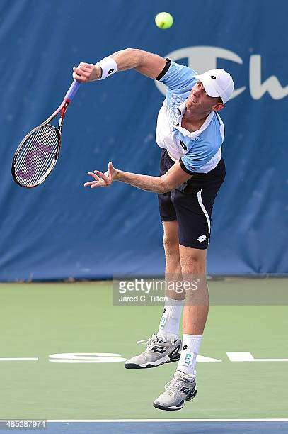 Kevin Anderson of South Africa serves to Jerzy Janowicz of Poland during the third day of the WinstonSalem Open at Wake Forest University on August...