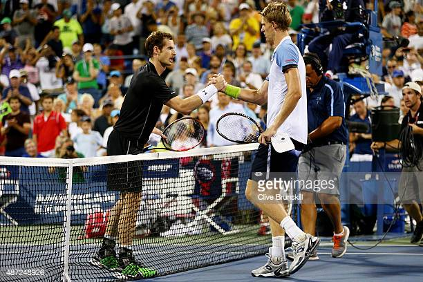 Kevin Anderson of South Africa shakes hands with Andy Murray of Great Britain after defeating him during their Men's Singles Fourth Round match on...