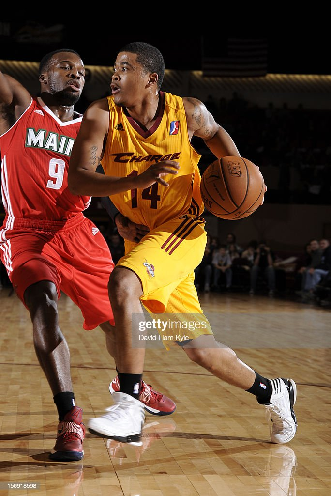 Kevin Anderson #14 of the Canton Charge drives to the hoop against Shelvin Mack #9 of the Maine Red Claws at the Canton Memorial Civic Center on November 23, 2012 in Canton, Ohio.